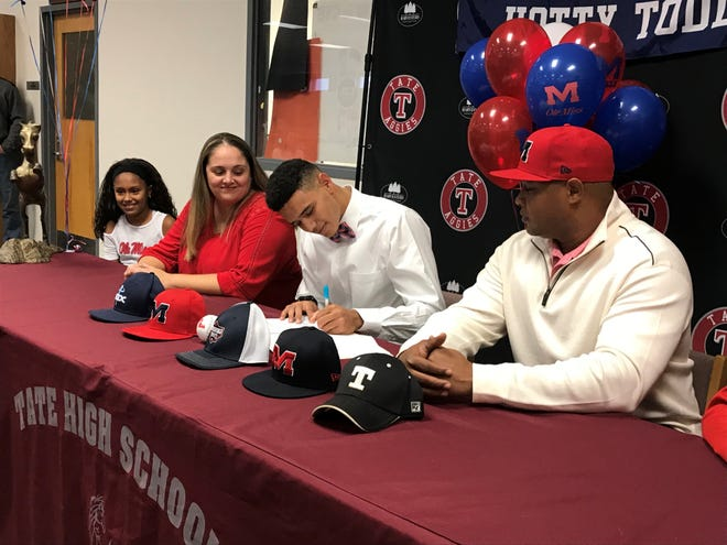 Tate High's Trey LaFleur signs with Ole Miss on Tusday joined by (left to right) Nyah LaFleur, Lee-Anne LaFleur and Raymond LaFleur.