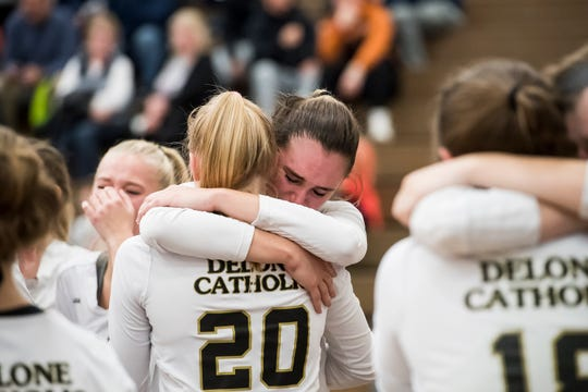Delone Catholic's Madddie Clabaugh and Brooke Lawyer (20) embrace after falling to Holy Redeemer in a PIAA 2A semifinal game at Exeter Township High School in Reading on Tuesday, November 13, 2018. The Squires fell in five sets; 23-25, 25-13, 25-13, 18-25, 15-10.