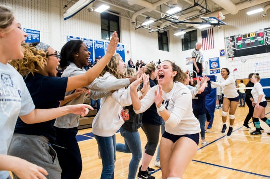 West York's Taylor Morley (17) celebrates with her teammates and fans after the Bulldogs defeated Allentown Central Catholic in a PIAA 3A semifinal game at Exeter Township High School in Reading on Tuesday, November 13, 2018.