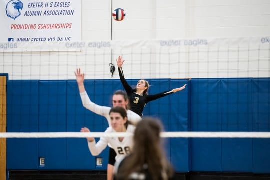 Delone Catholic's Lauren Trummer serves to Holy Redeemer during a PIAA 2A semifinal game at Exeter Township High School in Reading on Tuesday, November 13, 2018. The Squires fell in five sets; 23-25, 25-13, 25-13, 18-25, 15-10.