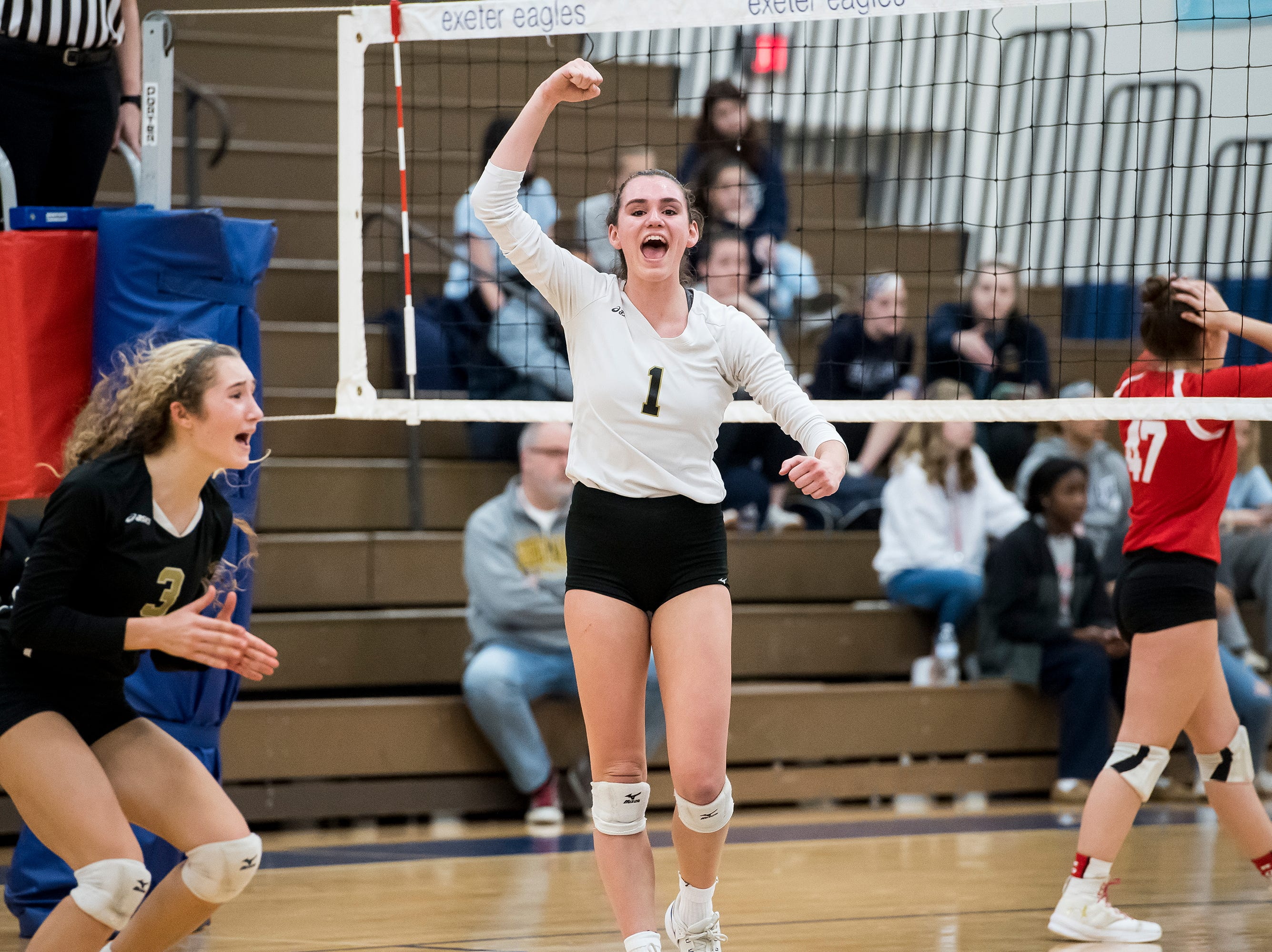 Delone Catholic's Maddie Clabaugh (1) reacts after scoring a point in a PIAA 2A semifinal game against Holy Redeemer at Exeter Township High School in Reading on Tuesday, November 13, 2018. The Squires fell in five sets; 23-25, 25-13, 25-13, 18-25, 15-10.