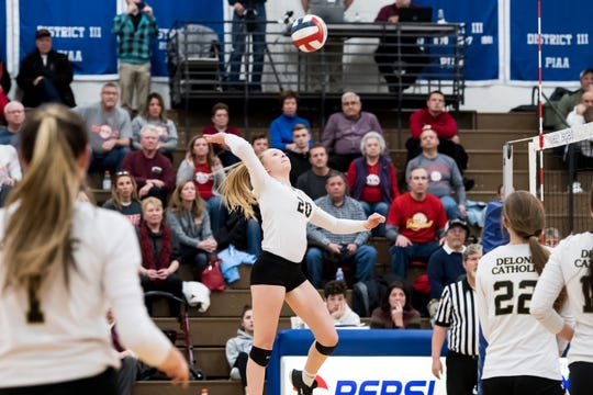 Delone Catholic's Brooke Lawyer jumps to hit the ball over the net during a PIAA 2A semifinal game against Holy Redeemer at Exeter Township High School in Reading on Tuesday, November 13, 2018. The Squires fell in five sets; 23-25, 25-13, 25-13, 18-25, 15-10.