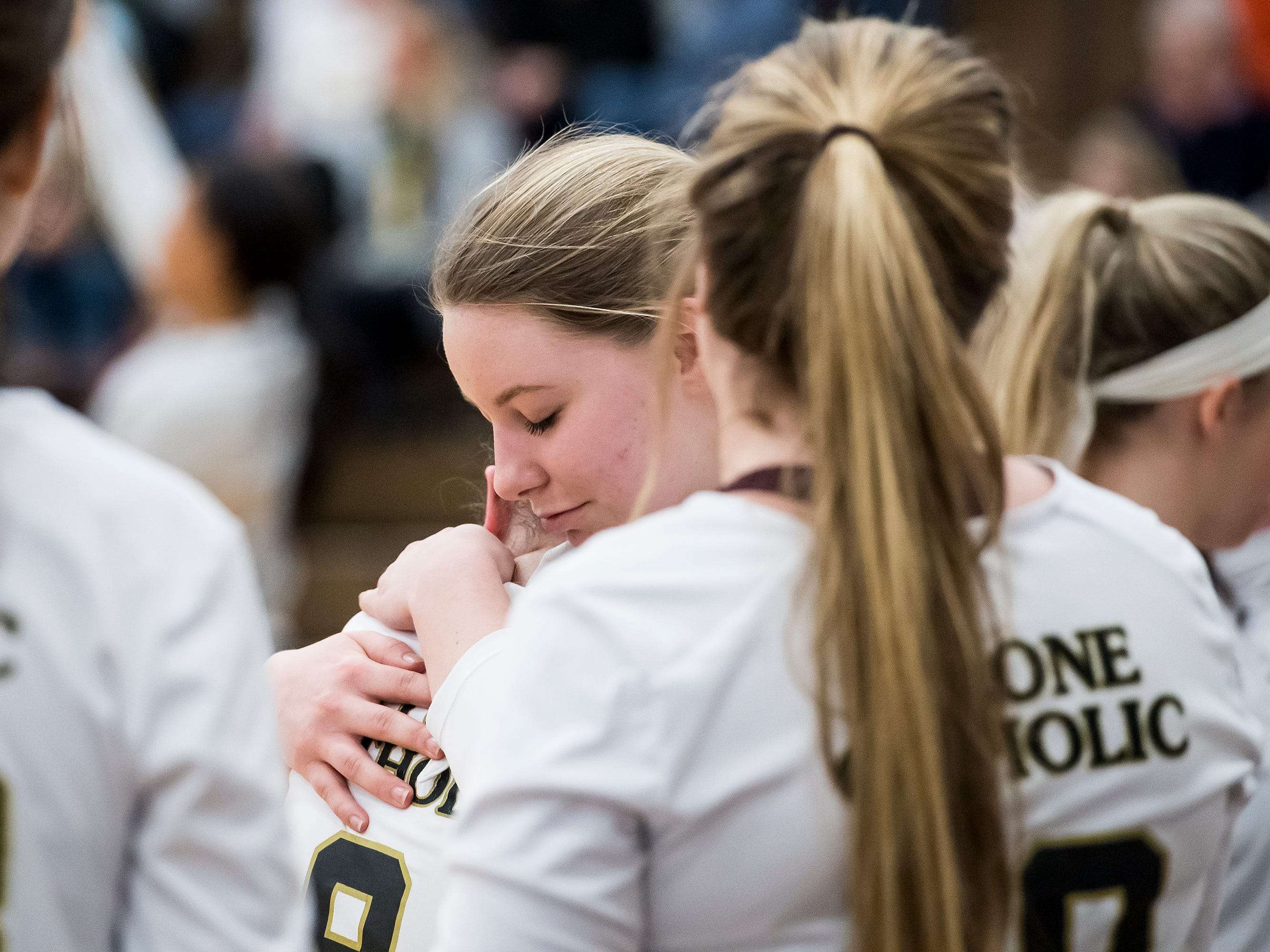 Delone Catholic players console one another after falling in a PIAA 2A semifinal game against Holy Redeemer at Exeter Township High School in Reading on Tuesday, November 13, 2018. The Squires fell in five sets; 23-25, 25-13, 25-13, 18-25, 15-10.