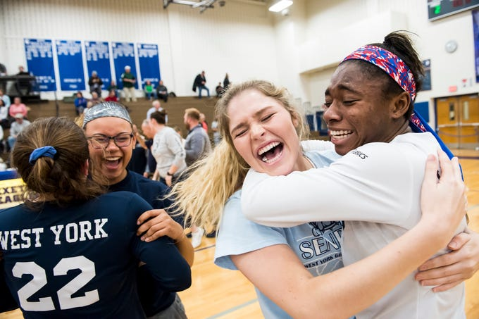 West York's Tesia Thomas, right, celebrates with teammates after the Bulldogs defeated Allentown Central Catholic in a PIAA 3A semifinal game at Exeter Township High School in Reading on Tuesday, November 13, 2018.