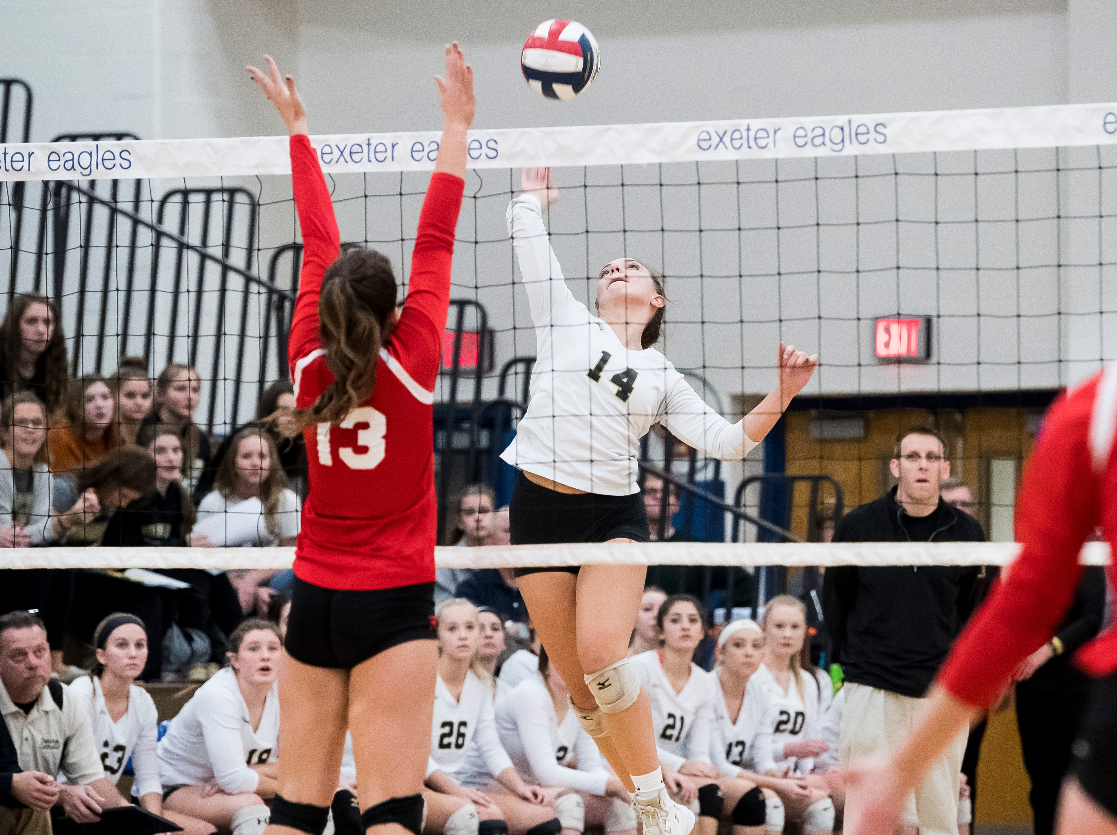 Delone Catholic's Molly Raville jumps to hit the ball over the net during a PIAA 2A semifinal game against Holy Redeemer at Exeter Township High School in Reading on Tuesday, November 13, 2018. The Squires fell in five sets; 23-25, 25-13, 25-13, 18-25, 15-10.