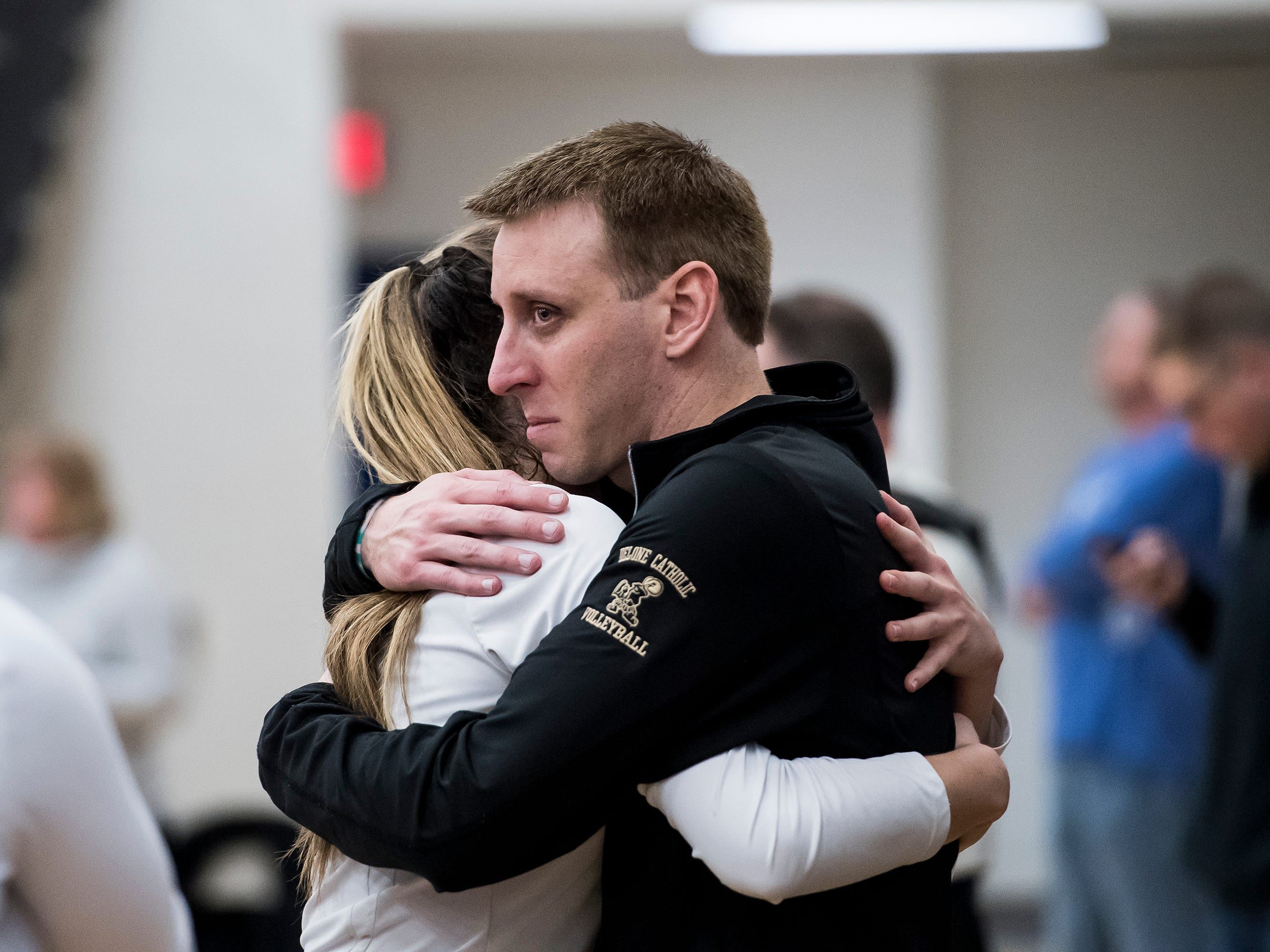 Delone Catholic head coach Jason Leppo hugs Maddie Clabaugh after the Squires fell in a PIAA 2A semifinal game against Holy Redeemer at Exeter Township High School in Reading on Tuesday, November 13, 2018. The Squires fell in five sets; 23-25, 25-13, 25-13, 18-25, 15-10.