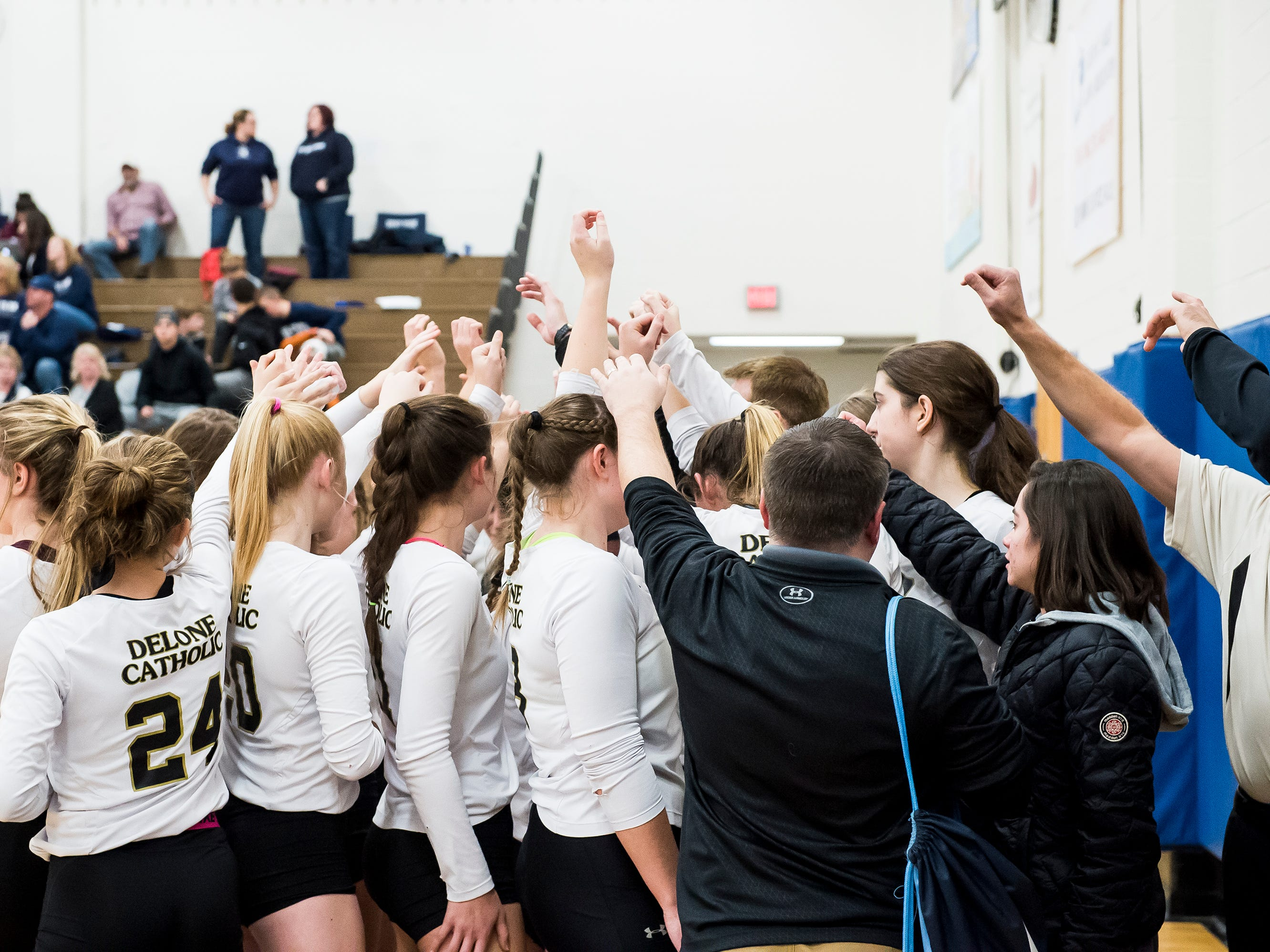 Delone Catholic break out of a huddle for the last time this season after falling in a PIAA 2A semifinal game at Exeter Township High School in Reading on Tuesday, November 13, 2018. The Squires fell to Holy Redeemer in five sets; 23-25, 25-13, 25-13, 18-25, 15-10.