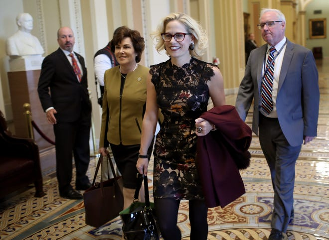 Democratic Senators-elect Kyrsten Sinema, D-Arizona, (left) and Jacky Rosen, D-Nevada, (right) walk to the office of Senate Minority Leader Chuck Schumer for a meeting at the U.S. Capitol Nov. 13, 2018, in Washington, D.C.