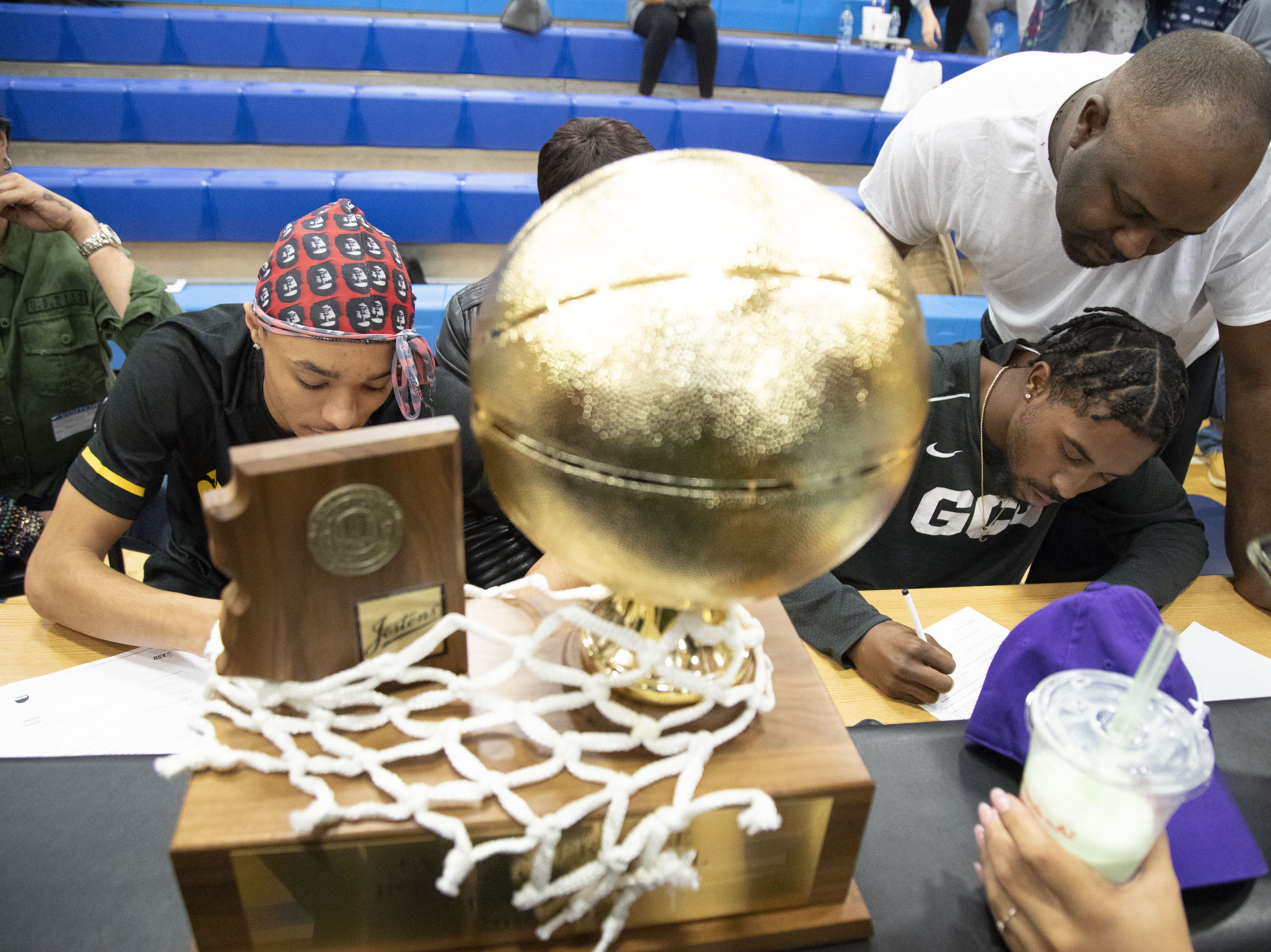 Students cheer Shadow Mountain High School senior's guard Jaelen House, on left  and Jovan Blacksher during the signing ceremony at the school gym. Jaelen House signs with Arizona State, and Jovan Blacksher signs with Grand Canyon University.