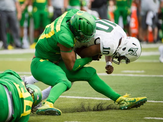 Oregon Ducks linebacker Jalen Jelks (97) sacks Portland State Vikings quarterback Jalani Eason (10) earlier this season. Jelks was a standout at Phoenix Desert Vista High before going to Oregon.