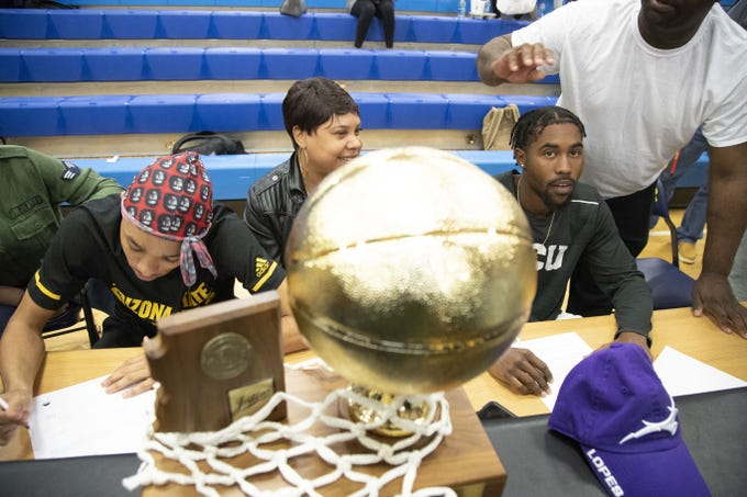Students cheer Shadow Mountain High School senior's guard Jaelen House and Jovan Blacksher during the signing ceremony at the school gym. Jaelen House signs with Arizona State,  and Jovan Blacksher signs with Grand Canyon University.