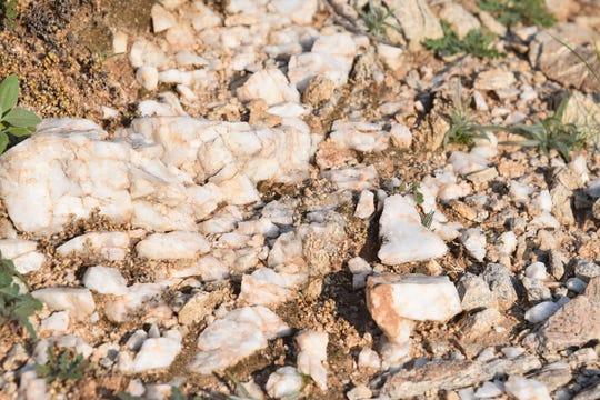 Milky quartz spills from fractured cliffs.