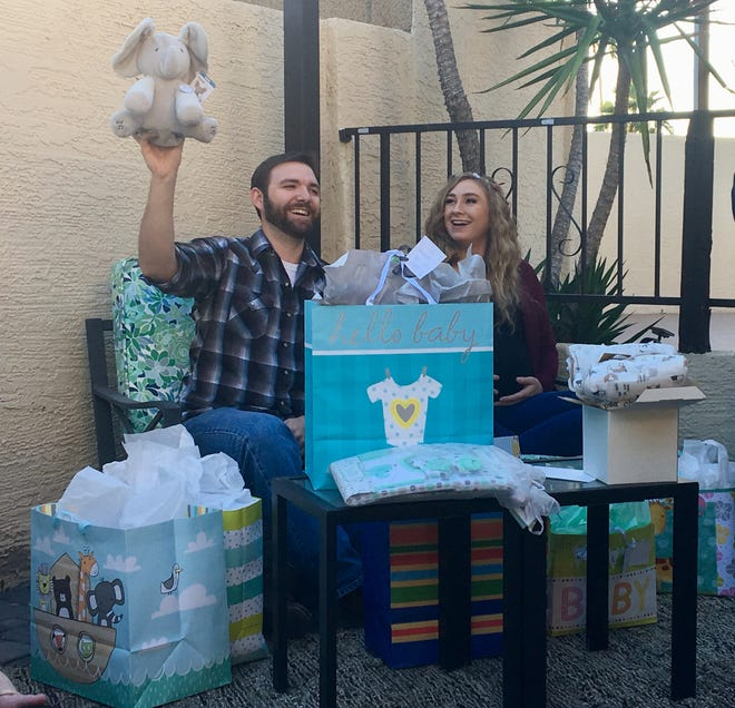 """My cousin Virgil and Tamatha open presents at their baby shower, including a stuffed elephant that plays """"Do Your Ears Hang Low."""""""