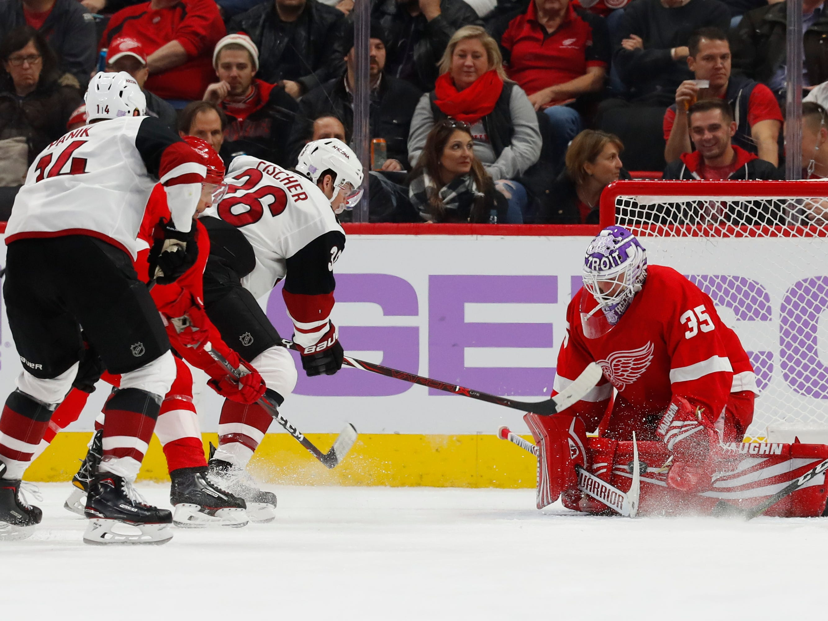 Detroit Red Wings goaltender Jimmy Howard (35) stops a Arizona Coyotes right wing Christian Fischer (36) shot in the second period of an NHL hockey game Tuesday, Nov. 13, 2018, in Detroit.