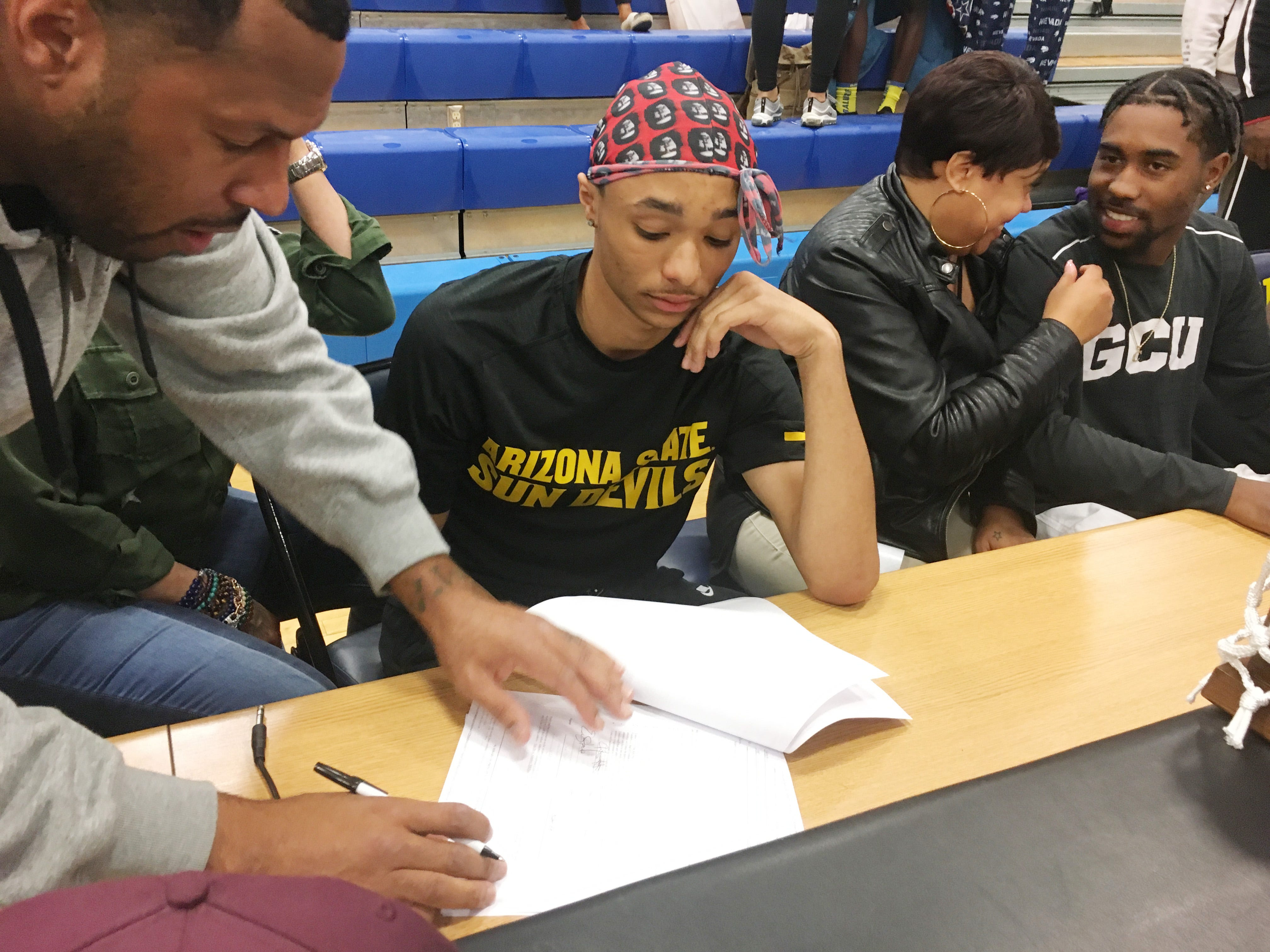 Shadow Mountain's Jaelen House with his father Eddie House during a signing ceremony at the school gym. Jaelen House signed with Arizona State.