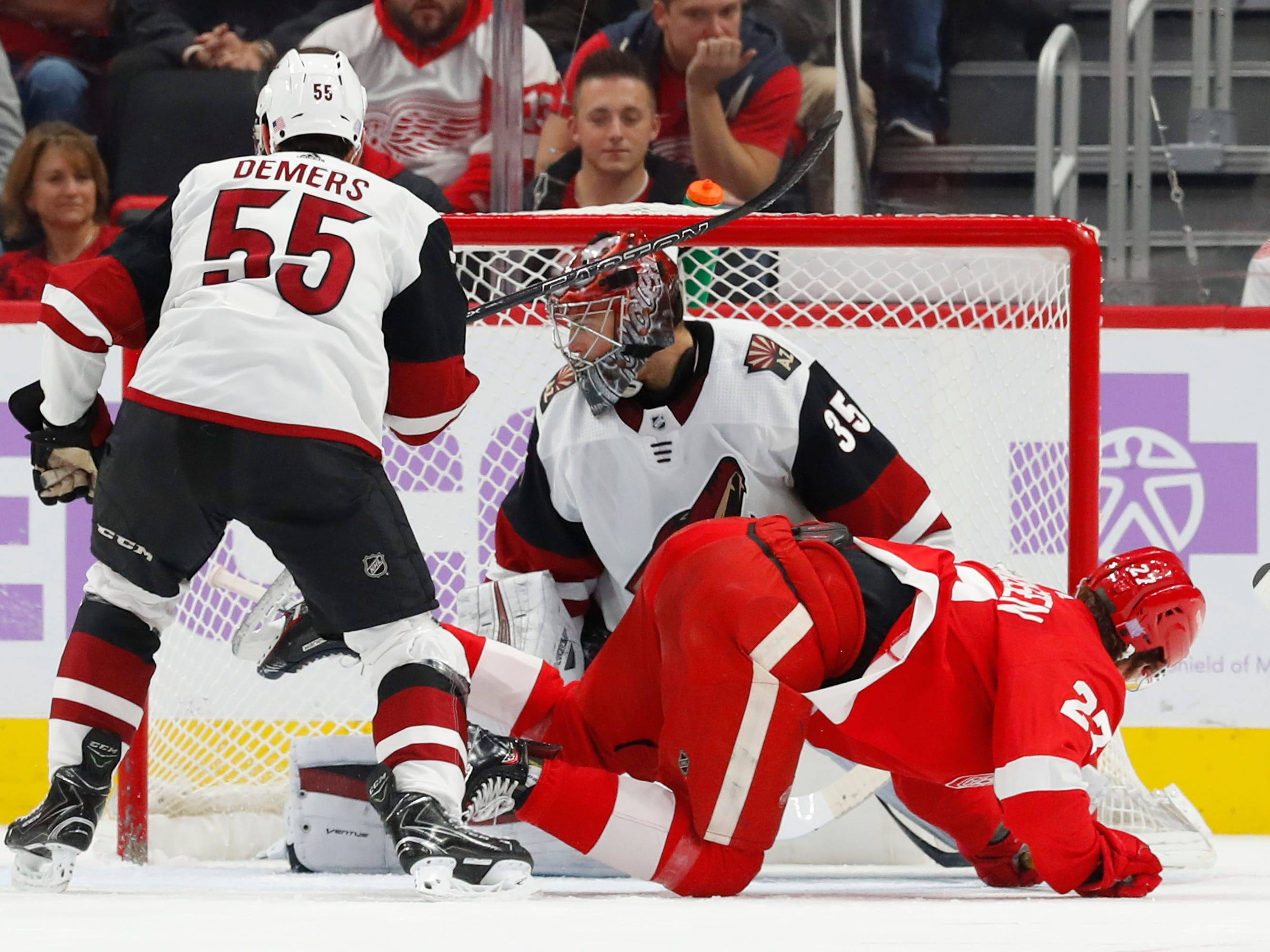 Detroit Red Wings center Michael Rasmussen (27) scores on Arizona Coyotes goaltender Darcy Kuemper (35) in the first period of an NHL hockey game Tuesday, Nov. 13, 2018, in Detroit.