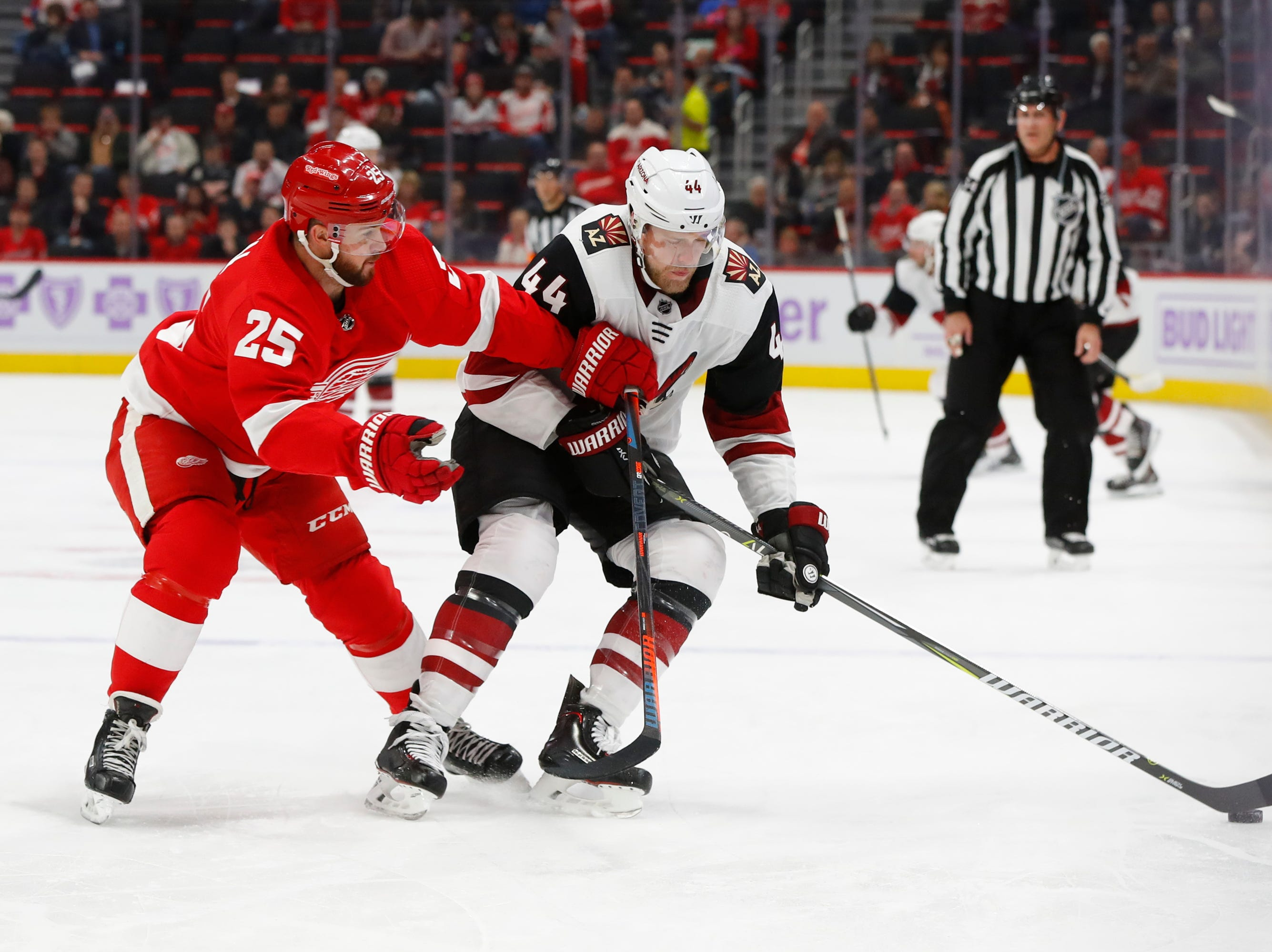 Detroit Red Wings defenseman Mike Green (25) defends Arizona Coyotes defenseman Kevin Connauton (44) in the first period of an NHL hockey game Tuesday, Nov. 13, 2018, in Detroit.