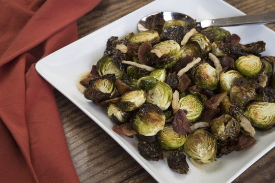 Roasted Brussels sprouts with crispy onions prepared by Robin Miller, Nov. 13, 2018, in Scottsdale.