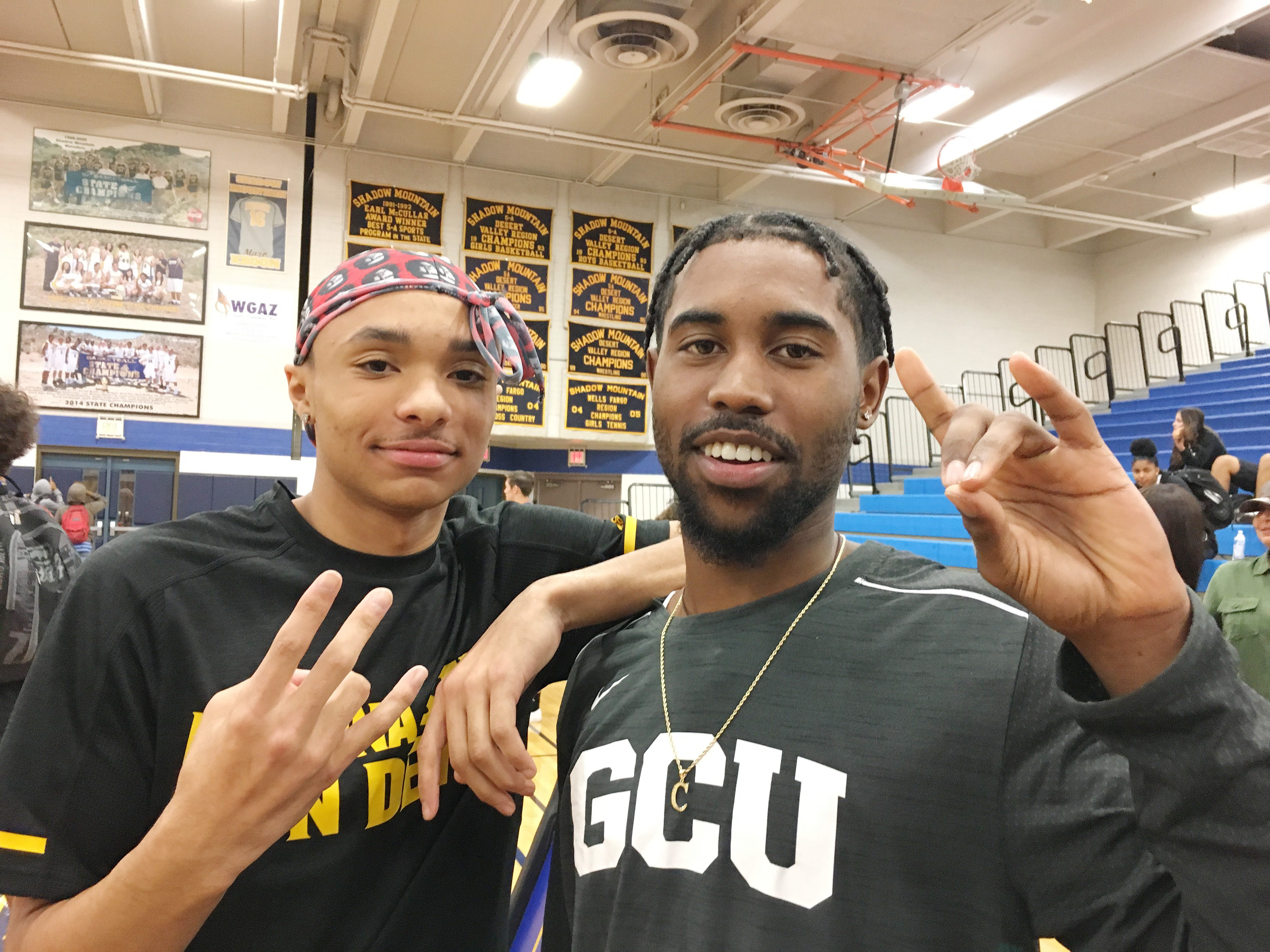 Shadow Mountain High School senior Jaelen House (left) and teammate Jovan Blacksher pose for a photo during a signing-day ceremony at the school gym. Jaelen House signed with Arizona State and Jovan Blacksher signed with Grand Canyon.
