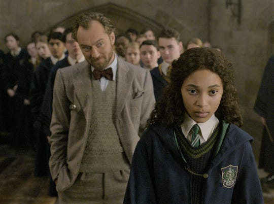 "Albus Dumbledore (Jude Law) instructs   Leta Lestrange (Thea Lamb) in ""Fantastic Beasts: The Crimes of Grindelwald."""