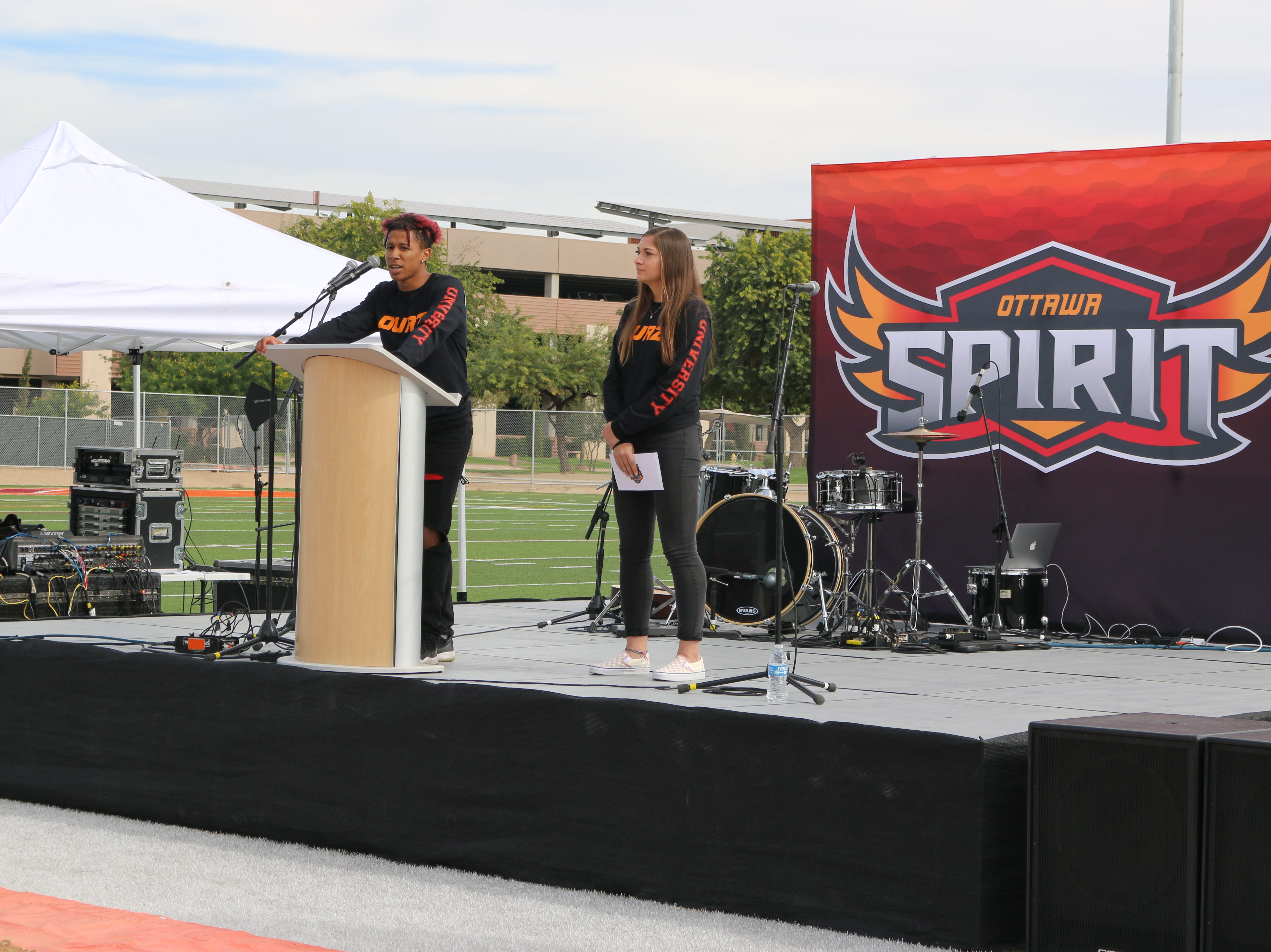 Ottawa students Miranda Ruiz and Tyler Thomas speak at the groundbreaking for the residence hall at the Surprise campus.