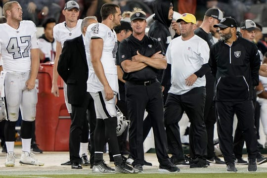 Raiders quarterback Derek Carr talks with coach Jon Gruden during a game against the 49ers on Nov. 1 at Levi's Stadium.