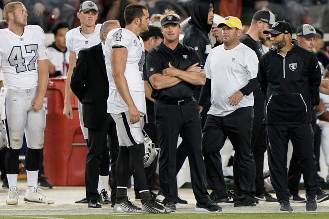 Nov 1, 2018; Santa Clara, CA, USA; Oakland Raiders quarterback Derek Carr (4) discusses the game with Oakland Raiders head coach Jon Gruden versus San Francisco 49ers at Levi's Stadium. Mandatory Credit: Stan Szeto-USA TODAY Sports