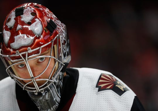 Arizona Coyotes goaltender Darcy Kuemper plays against the Detroit Red Wings in the second period of an NHL hockey game Tuesday, Nov. 13, 2018, in Detroit.