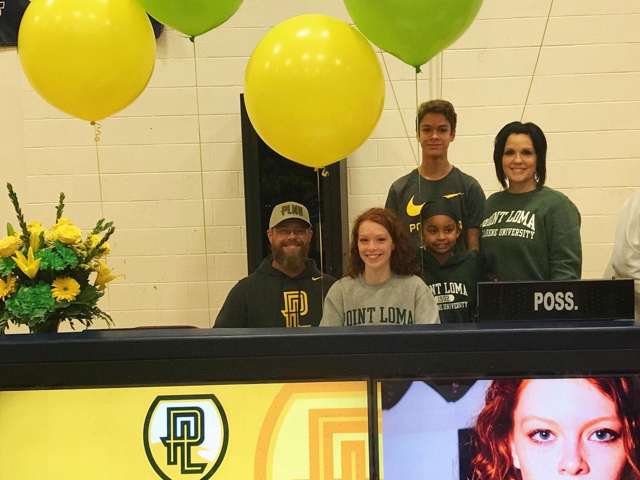 Scottsdale Christian basketball player Kylie Hearn signs with Point Loma on Nov. 14, 2018.