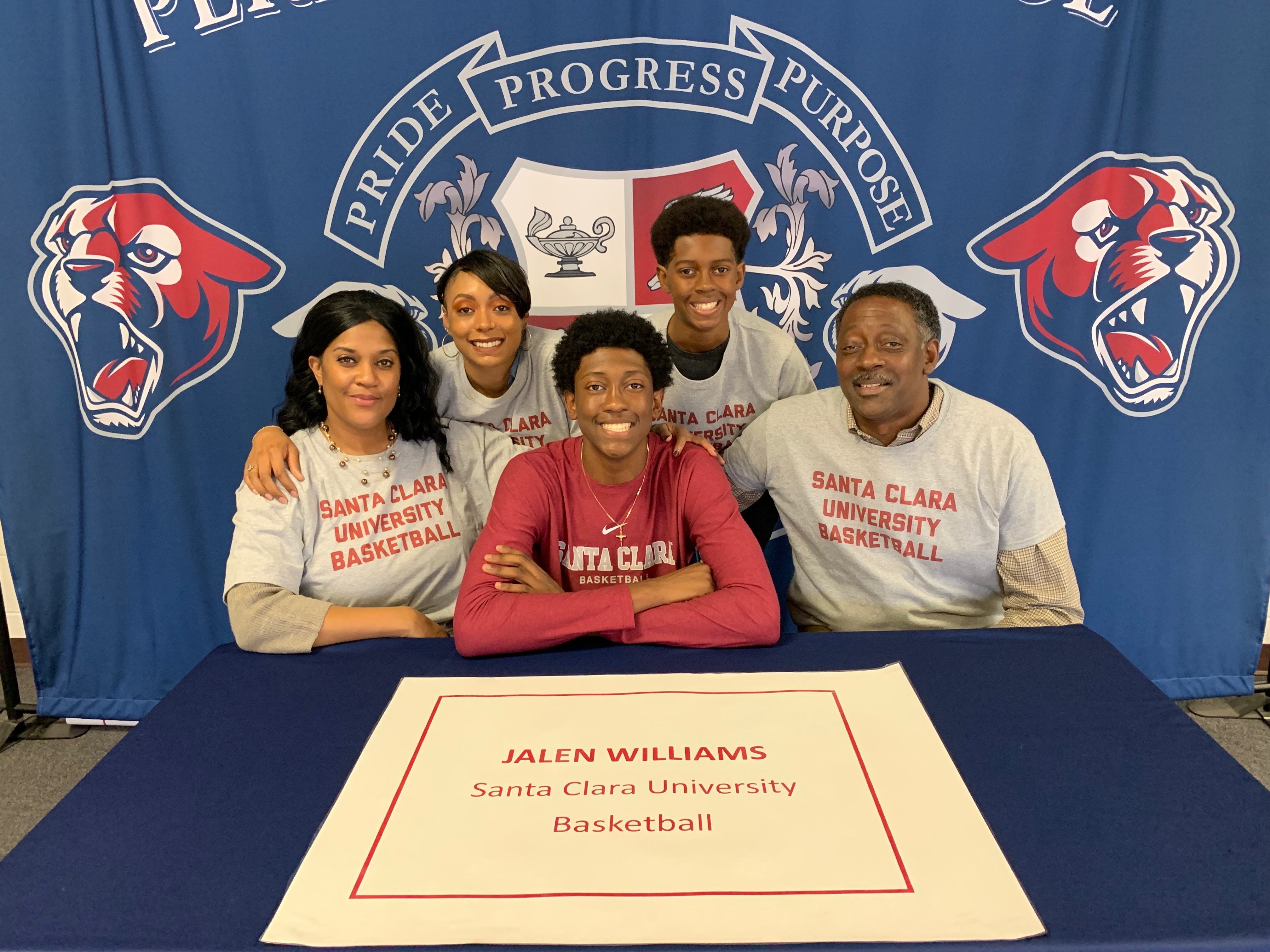 Perry basketball player Jalen Williams poses with his family after signing with Santa Clara on Nov. 14, 2018.