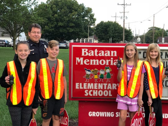 Bataan Memorial Intermediate School students use radios donated by the Port Clinton Fire Department for safety patrol at the elementary school. From left are Marissa Frohne, Officer J.R. Cipiti, Isaac Apple, Gabrielle Heilmann, and Olivia Althaus