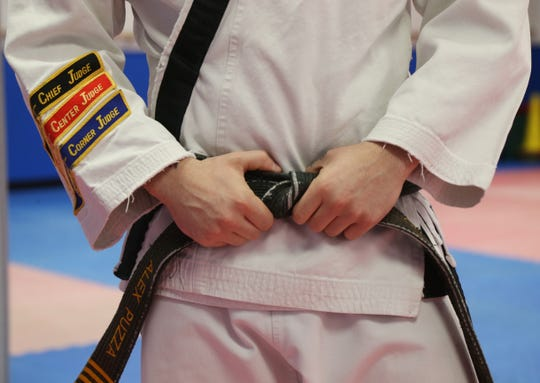Close up of Alex Puzza's gi, including his black belt at Proven Martial Arts in Wappingers Falls on November 9, 2018.