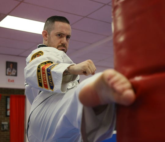 Alex Puzza works out at Proven Martial Arts in Wappingers Falls on November 9, 2018. Puzza started as a student when he was 8 years old and now owns the business and teaches students martial arts.