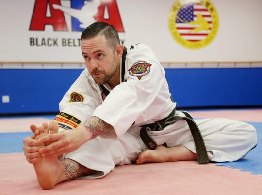 Alex Puzza stretches before working out at Proven Martial Arts in Wappingers Falls on November 9, 2018.