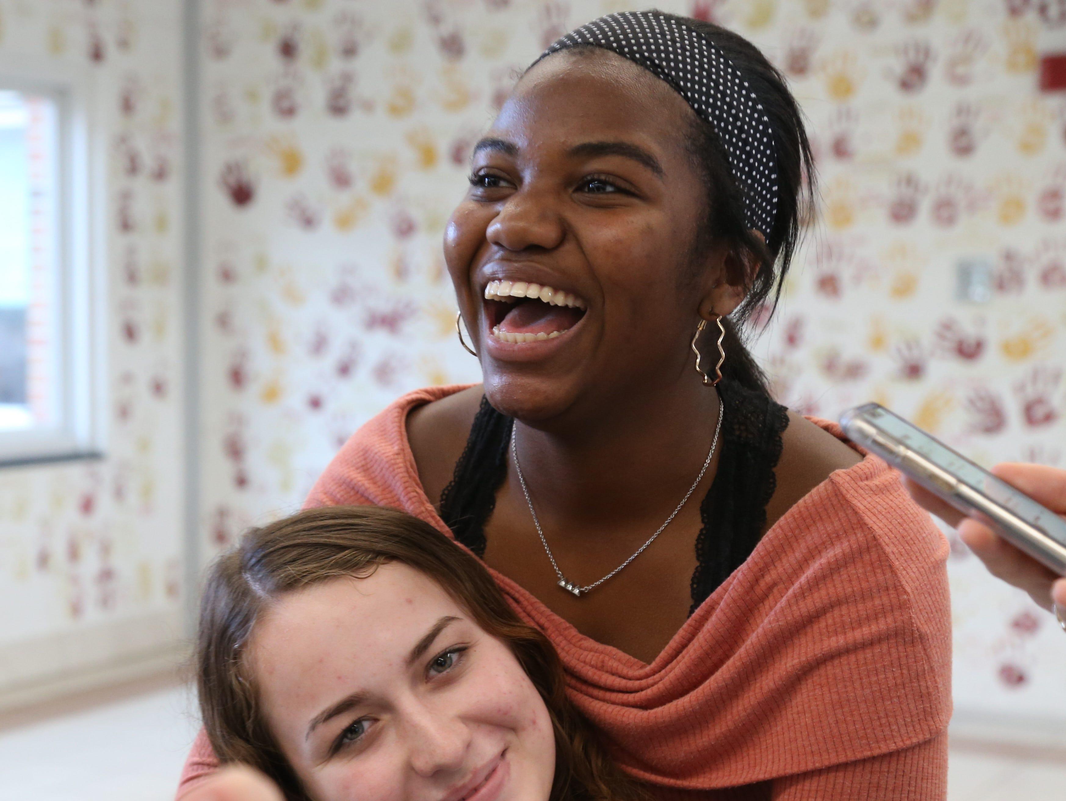 Mikaela McNeil with her field hockey teammate Kayleigh Howard at Arlington High School in Freedom Plains on November 14, 2018.