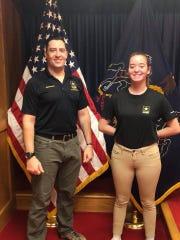 Breana Stine stands with her recruitment officer, Staff Sgt. Daniel Harubin on Oct. 19 after officially enlisting in the U.S. Army infantry.
