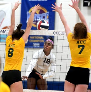 West York's Tesia Thomas, center, seen here in a file photo, is the York-Adams Division II Girls' Volleyball Player of the Year for the second time in her career.