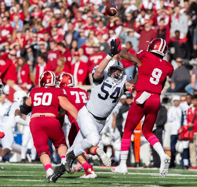 Penn State defensive tackle Robert Windsor (54) closes in on Indiana quarterback Michael Penix Jr. (9) earlier this season. Windsor is part of a Penn State defense that is coming off one of its best games in a 22-10 win over Wisconsin. (AP Photo/Doug McSchooler)
