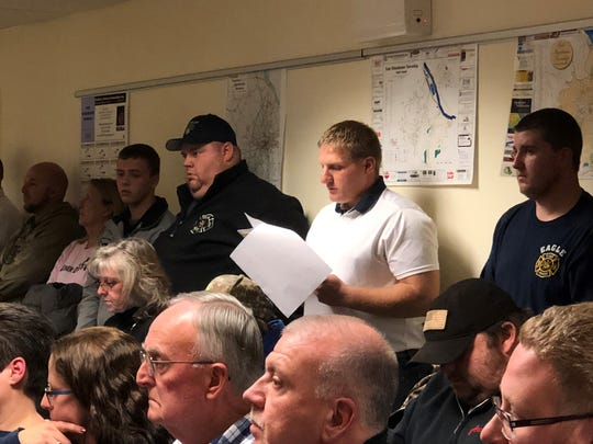 Fire Chief Jacob Bush, center, of Eagle Fire Co. in Mount Wolf, reads a statement at the East Manchester Township supervisors meeting Tuesday, Nov. 13.