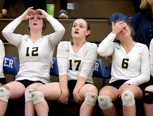 From left, Delone Catholic's Katie Kohler, Tessa Beauchat and Allie Colgan react from the bench during the fifth game against Holy Redeemer during the Class 2-A state semifinal at Exeter Township High School Tuesday, Nov. 13, 2018. Delone would lose the game and the match. Bill Kalina photo