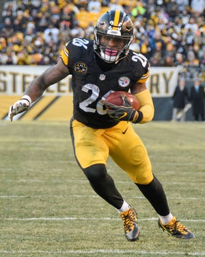 Running back Le'Veon Bell won't be playing with the Pittsburgh Steelers this season. AP FILE PHOTO