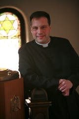 The Rev. Virgil Tetherow, who's also known as Father Gabriel, is seen inside a church in York in 2009. He now runs St. Michael the Archangel Roman Catholic Church in Lower Windsor Township.