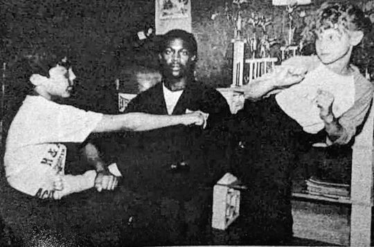 Gary Hopkins Sr., center, works with students in this photo from around 1983.