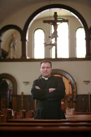 The Rev. Virgil Tetherow, who's also known as Father Gabriel, is seen in this photo from 2009 inside Saints Peter & Paul Roman Catholic Mission in York. The Board of Directors of Saints Peter & Paul Roman Catholic Mission fired him in 2010.