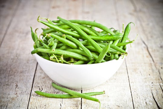 Green beans and other vegetables can be purchased four or five days before Thanksgiving; they'll keep if properly dried and stored.