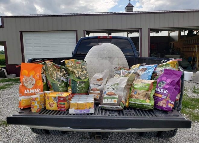 Pet food and a shelter are ready for delivery by the Warm Paws Cool Claws Project.