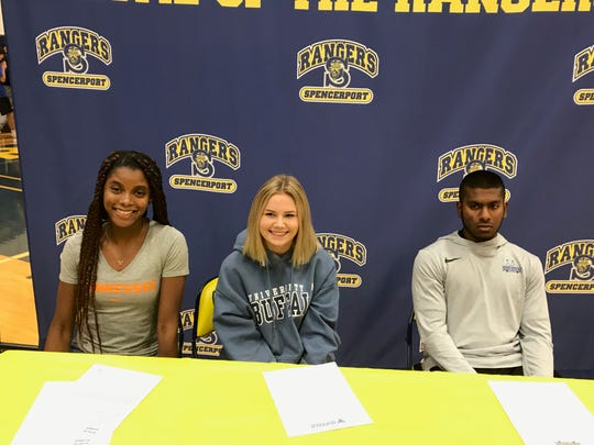 Spencerport seniors Vanessa Watson, far left, Leah Wengender and Ajan Rajamohan after they have announced their choices for college.