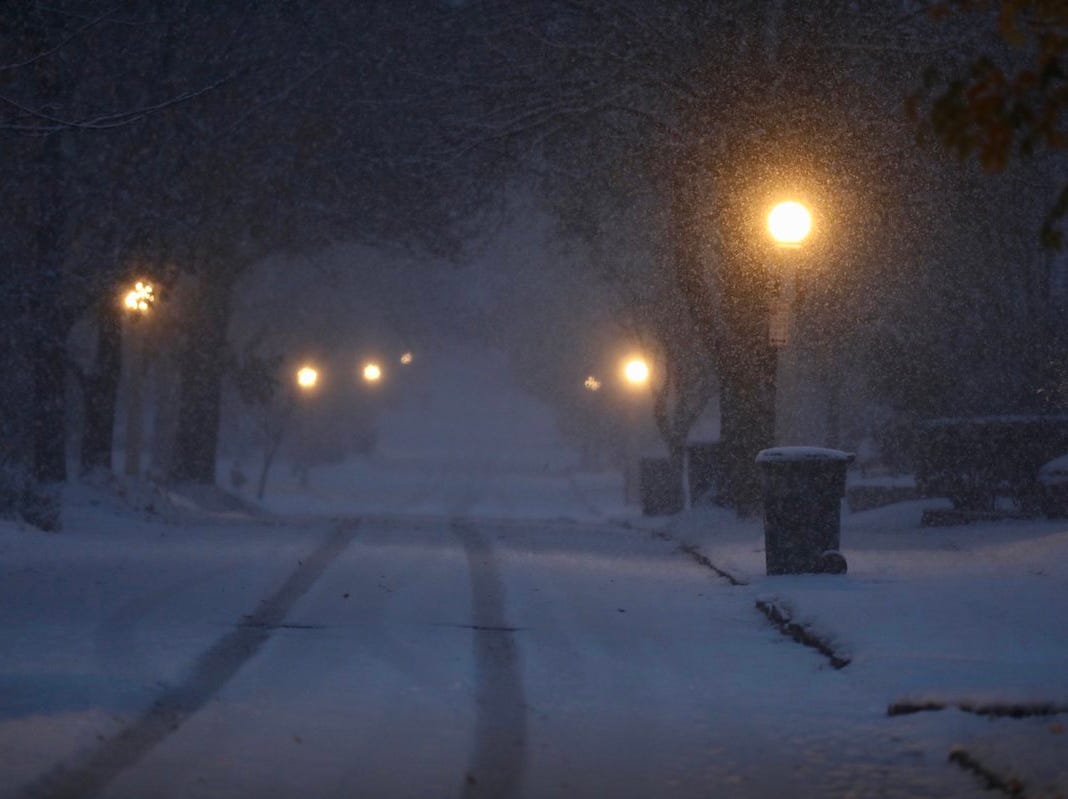 Snow covers streets around Rochester before the morning commute.