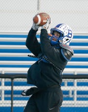 Batavia running back Ray Leach catches a pass during practice at Genesee Community College this week.