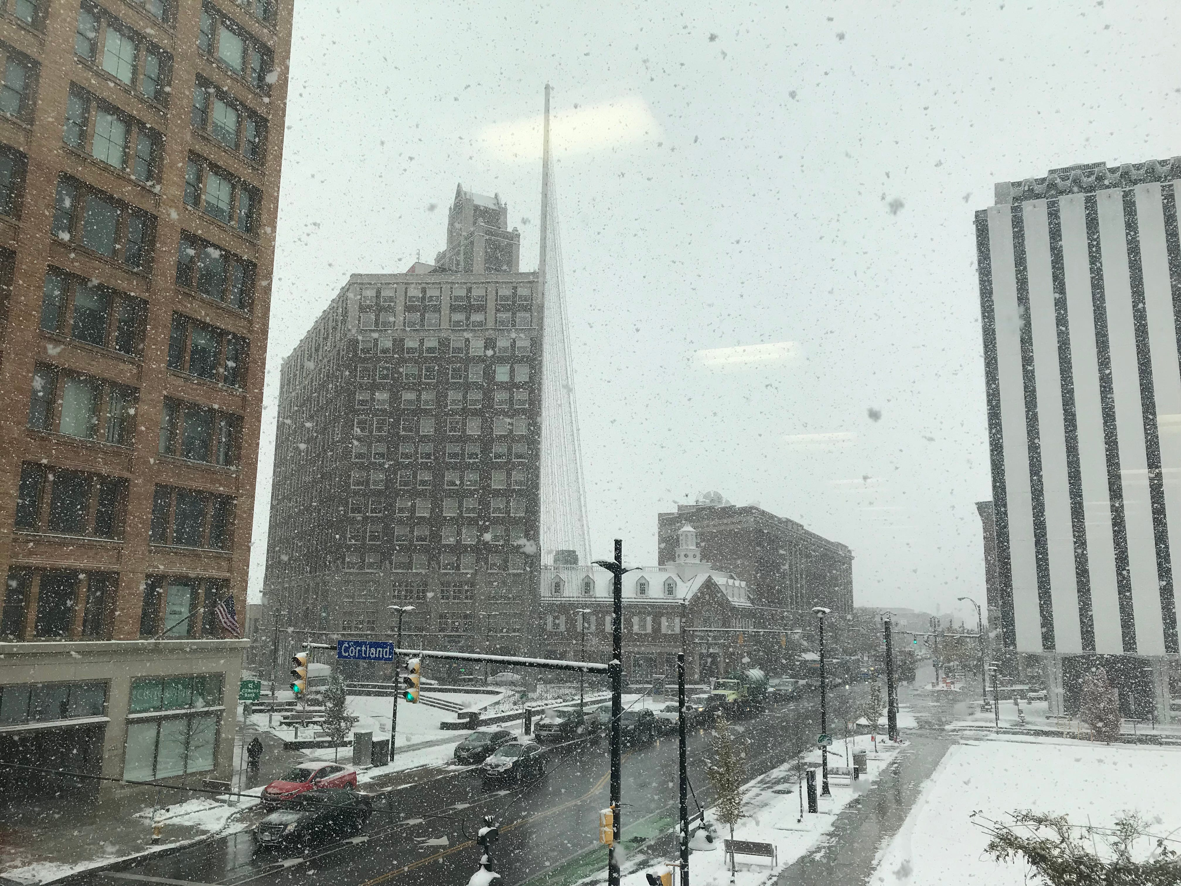 Snow hits downtown Rochester.